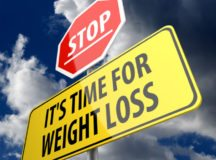 Stop it is time for weight loss words on road sign