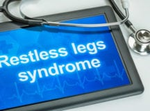 Tablet with the diagnosis Restless legs syndrome on the display